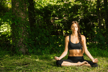 Young woman doing meditation in nature