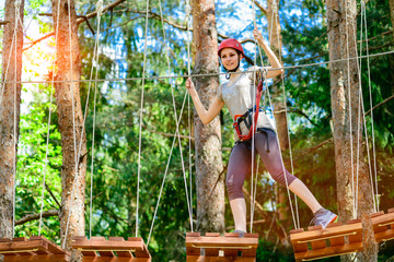 adventure climbing high wire park - Young woman on course in mou