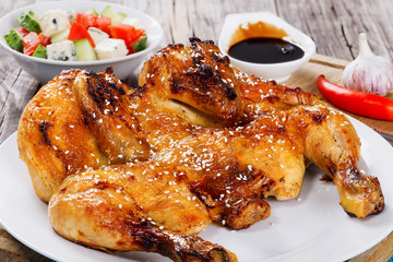 Grilled whole chicken and salad in white bowl
