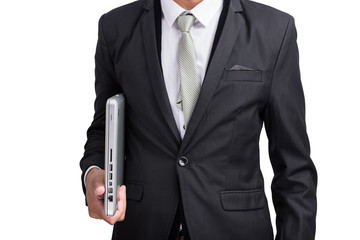 Yong businessman holding laptop