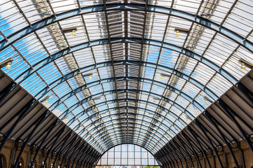 Aluminium Prints Train Station Ceiling arch of Kings Cross train station in London, UK