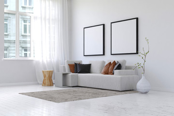 Living room with sofa pair of blank picture frames
