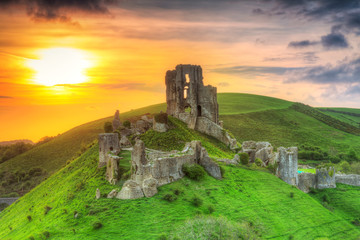 Foto op Canvas Kasteel Ruins of the Corfe castle at beautiful sunrise in County Dorset, UK