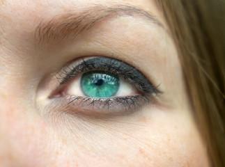 Green female eye close-up