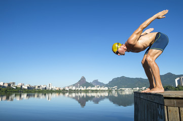 Athlete swimmer with yellow swimming cap in the start position for a race at the Lagoa Rodrigo de Freitas lagoon in Rio de Janeiro, Brazil