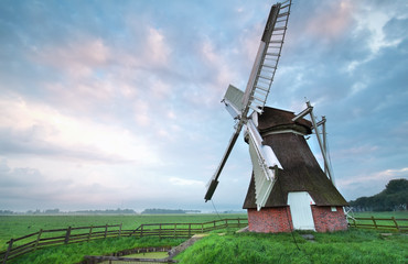 Dutch windmill at summer sunrise