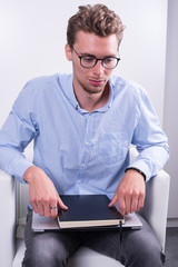 smart young professional with notebook on his knees