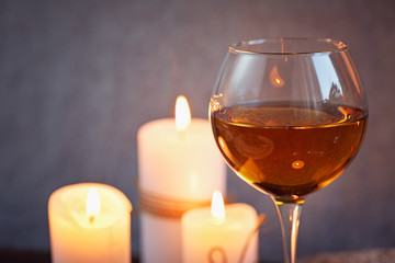 Romantic dinner with wine and candles on a table