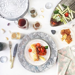 Dinner with salad, salmon, cherry and tea. Plate, dish and tray. Overhead view. Flat lay