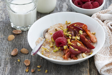 oatmeal with baked fruit and pistachios for breakfast