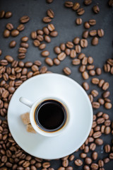 espresso coffee on roasted coffee beans