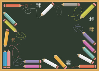Colorful pencils isolated on green school board