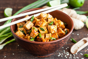 Fried tofu with sesame seeds and spices
