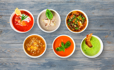 Variety of soups at blue wood, top view