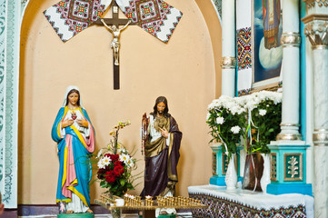 Plaster figure of Jesus Christ and Holy Mary at church