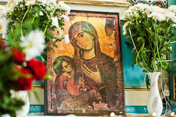 Old wooden image icon of the Mother of God Mary and child Jesus