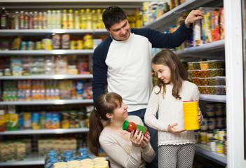 Ordinary family buying canned food