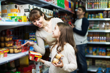 Family buying pudding in shop