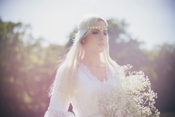 Bride with white flowers in nature