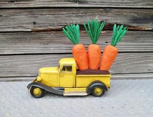 Carrot Truck - Little yellow truck hauling paper mache carrots to market.