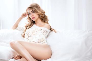 Sensual girl in bed relaxing.