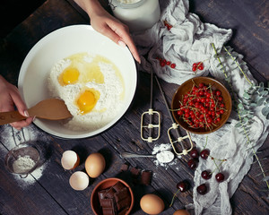 Baking background with ingredients for fruit and chocolate cake;