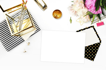 Flat lay. Flower on the table.Gold stapler. Table view. Mock-up background. Peonies. Stationery. Stripe notebook with gold box.
