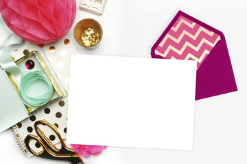 Stationery and envelope isolated on pink background. Modern background. Mock-up for your photo or text and work. Woman desktop, template card. Flat lay. Open envelope with blank