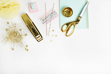 Header website or Hero website, view table gold accessories office items. Flat lay. Feminine workspace.