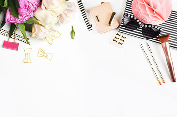Modern woman desk. Make up cosmetics, brushes and lipstick on white background top view. Gold stationery. Mock-up. Feminine scene. header site or hero site. Flat lay image.