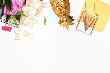 Mock up background, woman desk. Gold pineapple, flower. Flat lay. Accessories on the table, view top, desk top modern.