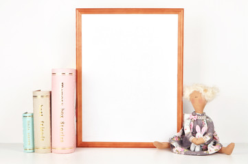 wooden picture frame with decorations. Mock up for your photo or text Place your work, print art,shabby style, white background, paper ball, toy, pastel color book
