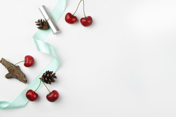 white background table, view table mockup, cherry and lipstick. Flat lay