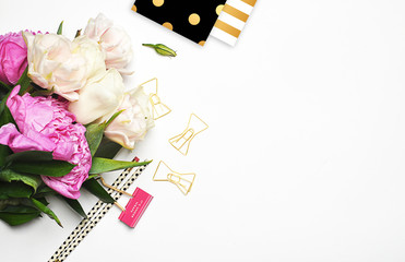 Peonies and gold. Office desktop. Flat lay. Glamour style. Stationery on white background. Flat lay