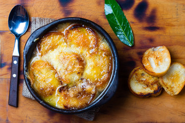 Onion soup with dried bread and cheese. Top view