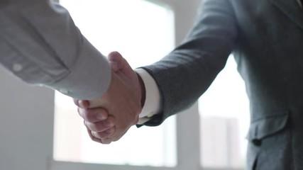 search photos handshaking