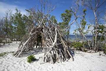 Driftwood tepee shelter built on the white sands of Fort Myers Beach, Florida