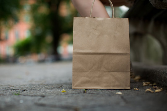 Standing brown paper bag outside