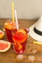 two glasses of fruit drink blackcurrant with hat on table
