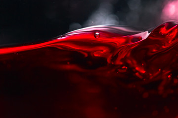 Red wine on black background Wall mural