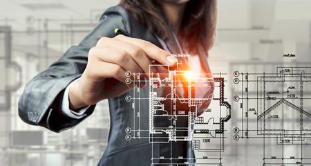 Woman engineer at work . Mixed media
