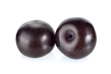 ripe black plum on white background