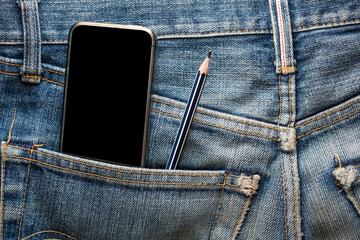 Mobile phone with pencil in back pocket faded jeans