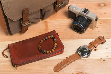 Outfit of traveler on old wooden background, Travel concept