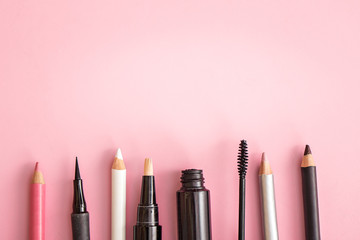 set of cosmetic products on pink background