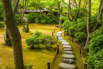 Stone path in Okochi Sanso, the former home and garden of the Japanpanese jidaigeki or period film actor Denjiro Okochi, located in Arashiyama, Kyoto, Japan