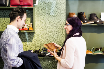 Man and woman in shoe store