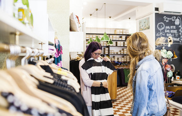 Women shopping dress in clothing store