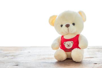Teddy bears sitting on a wooden floo