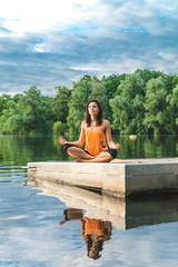 beautiful woman sitting in lotus pose